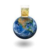 A whiskey glass on the earth. Elements of this image furnished by Stock Photos