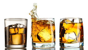 Whiskey in glass with ice set Stock Photography