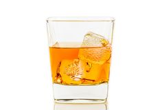 Whiskey in glass with ice on white background Royalty Free Stock Photo
