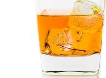 Whiskey in glass with ice on white background Royalty Free Stock Images