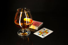 Whiskey glass and playing cards Stock Photography