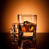 Whiskey in glass Stock Images