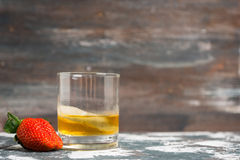 Whiskey in glass on the rustic background. Shallow depth of field Stock Images