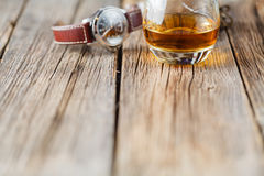 Whiskey glass with watch Royalty Free Stock Image