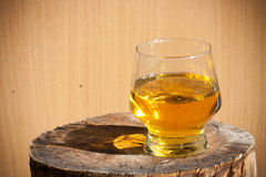 Whiskey in glass. On wood Stock Photos