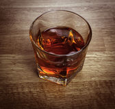 Whiskey glass. On a wooden background Royalty Free Stock Image