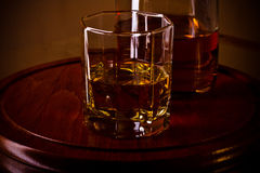 Whiskey glass on wooden tray Royalty Free Stock Images