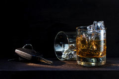 Whiskey glasses with ice and car keys on dark wood, concept  dri Royalty Free Stock Images