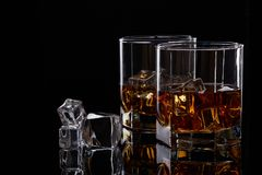 Whiskey glasses with ice. Royalty Free Stock Photo