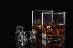 Whiskey glasses with ice. Royalty Free Stock Image
