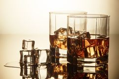 Whiskey glasses with ice. Royalty Free Stock Images
