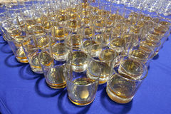 Whiskey glasses in a row Royalty Free Stock Images