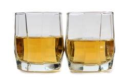 Whiskey glasses on white Stock Photos