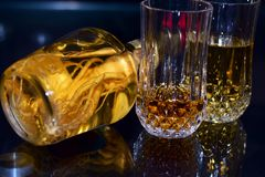 Free WHISKEY GLASSES WITH GINGER ROOT WINE BOTTLE Stock Images - 127605664