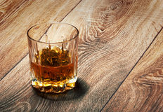 Whiskey in glasses on wooden Stock Photography