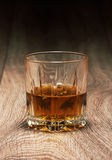 Whiskey in glasses on wooden Stock Images