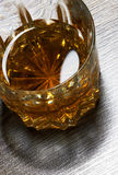 Whiskey in glasses on wooden Royalty Free Stock Photos