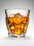 Whiskey on gray Royalty Free Stock Photos
