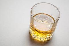 Whiskey on gray Royalty Free Stock Photo