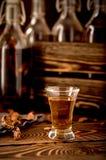 Whiskey hooch moonshine alcohol  herbs Stock Image