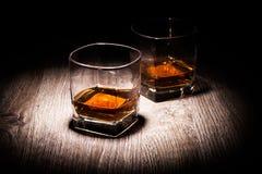Whiskey i exponeringsglas Royaltyfria Foton