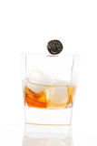 Whiskey with ice and cigar. Stock Photos
