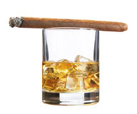 Whiskey with ice and cigar, isolated on white Royalty Free Stock Image