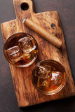 Whiskey with ice and cigar. Top view royalty free stock photography