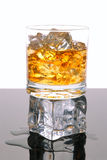 Whiskey on Ice Cube Royalty Free Stock Photos