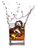 Whiskey with ice cubes Stock Images