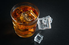 Whiskey with ice cubes Royalty Free Stock Photos