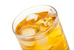 Whiskey with ice cubes. Isolated on white Royalty Free Stock Photos