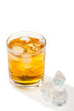 Whiskey with ice cubes. Isolated on white Stock Photos