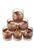 Whiskey and ice in cups Royalty Free Stock Images