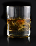 Whiskey with ice in a glass Stock Image
