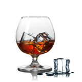 Whiskey with ice in glass isolated on white Stock Photography