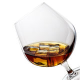 Whiskey with ice in glass isolated on white Stock Photo