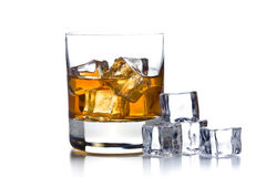 Whiskey with ice in glass. On white background Royalty Free Stock Photography
