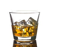 Whiskey with ice in glass Stock Photography