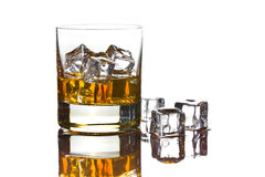 Whiskey with ice in glass Stock Images