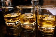 Whiskey with ice. Great photo on whiskey with ice on the black table Royalty Free Stock Image