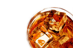Whiskey with ice isolated Royalty Free Stock Photo