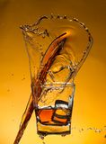 Whiskey with ice with liquid splash Royalty Free Stock Photo