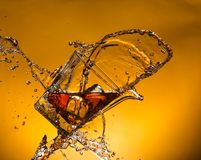 Whiskey with ice with liquid splash Royalty Free Stock Image