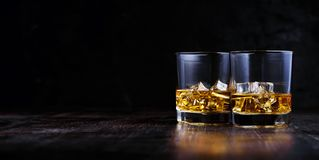 Whiskey with ice in modern glasses royalty free stock photos