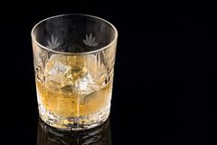 Whiskey with ice in rocks glass  on black background with clipping path Stock Images