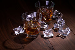 Whiskey with ice. Wood planks. Low key Royalty Free Stock Image
