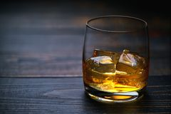 Whiskey with ice on a wooden table Royalty Free Stock Image