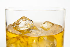 Whiskey and Ices. Closed-up of whiskey and ices in a glass with white isolated background Royalty Free Stock Photography