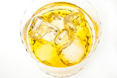 Whiskey and Ices. Closed-up of whiskey and ices in a glass with white isolated background Royalty Free Stock Image